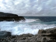 See how high these cliffs are, at Queen's Bath on Eleuthera! Just after I took this picture, the waves came up to drench me.