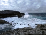 """Here's another look at the huge waves that were filling the Queen's Bath, just a few hundred feet south of the """"Glass Window Bridge."""". This was at low tide, too!"""